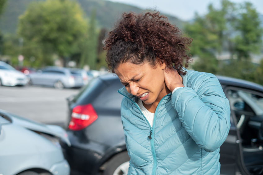 Woman feeling neck ache after bad cars pile up